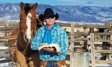 James with bible and his horse